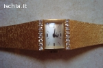 Omega donna in oro con diamanti